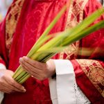priest with palms