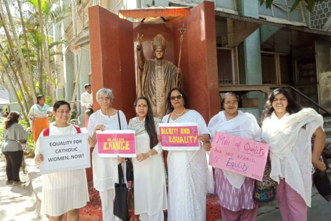 indian women wait for when cardinal gracias walks the talk Several of the signatories of the petition to Mumbai Cardinal Oswald Gracias stand together in front of a statue of Pope John Paul II near Mumbai's Holy Name Cathedral March 8. The author of the commentary is third from the left. Virginia Saldanha is second from the left. (Photo courtesy of Astrid Lobo Gajiwala/ Catholic Women's Council)