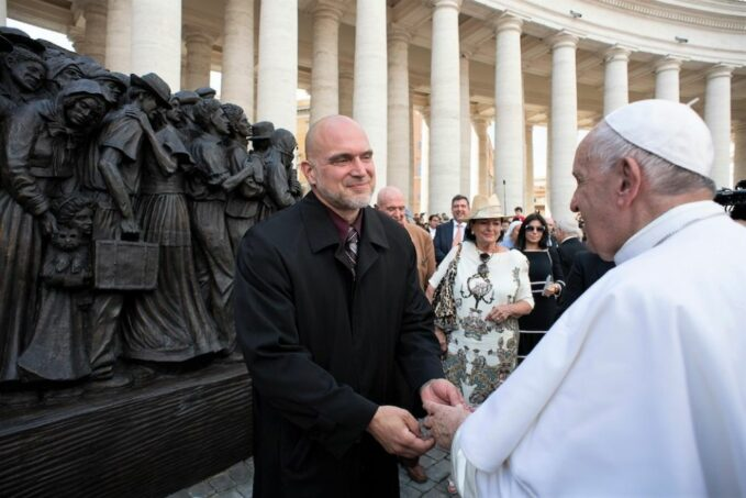 """timothy schmalzs sculptures are only as shocking as the gospels Pope Francis greets sculptor Timothy Schmalz at the unveiling of the monument to migrants and refugees, """"Angels Unawares,"""" at St. Peter's Square on World Day of Migrants and Refugees, Sept. 29, 2019. (Itravella/Wikimedia Commons)"""