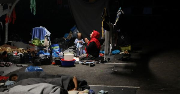 caritas official after refugee camp fire lesbos locals patrol streets Warsaw, Poland — The director of Greece's Catholic charitable organization said the situation on Lesbos island remains tense after a fire at a refugee camp left at least 12,000 homeless.
