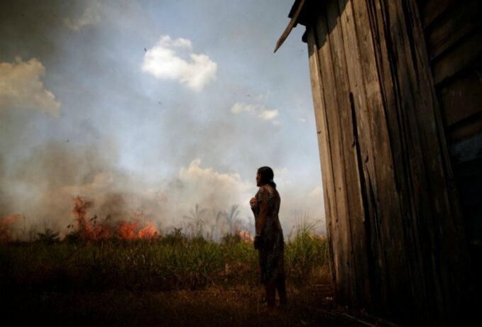 impeded by pandemic crisis dreams and goals of amazon synod endure Miraceli de Oliveira reacts as fire approaches her house in an area of the Amazon rainforest near Porto Velho, Brazil, Aug. 16. (CNS/Reuters/Ueslei Marcelino)