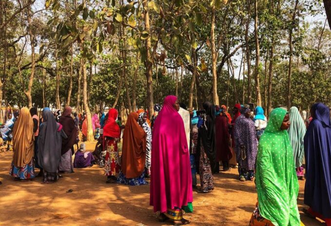 malaria coronavirus nigeria struggles to battle twin pandemics  A group of women gather outside Area 1 IDP Camp for internally displaced persons in Abuja, Nigeria. (Chinedu Asadu)